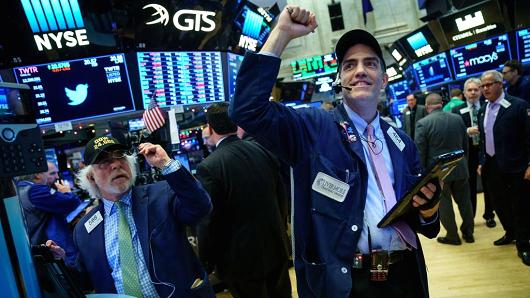 Dow soars 230 points higher to record as Street cheers Senate passing tax bill.