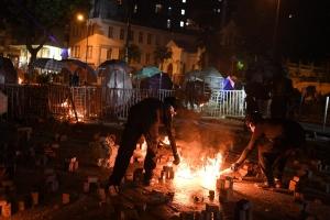 Hong Kong protesters hurl petrol bombs in fresh university clashes