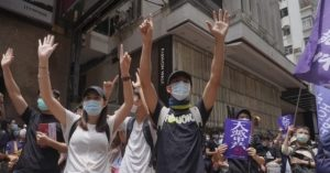 Hong Kong Police Fire Tear Gas, Water Cannon at Protesters – Breitbart