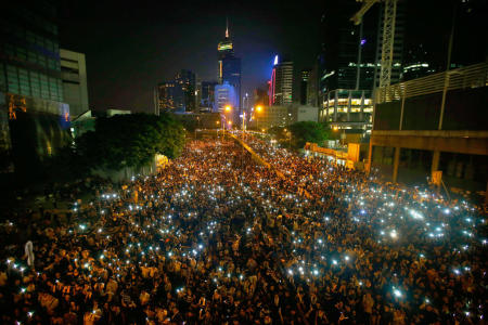 Hong Kong Protesters Defy Officials' Call to Disperse