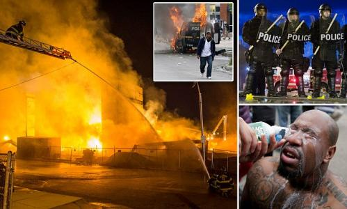 Huge fires set across Baltimore as Freddie Gray rioters torch city, loot stores and injure fifteen police officers as violence rages into the night and local politicians are left turning on each other