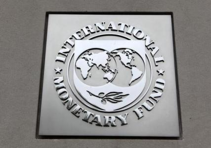 IMF lowers global growth forecasts, cites U.S. weakness