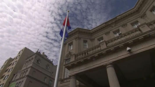 COMMUNIST CUBA FLAG RAISED AT EMBASSY IN WASHINGTON