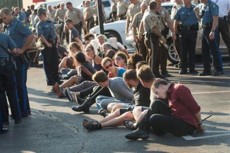 FERGUSON PROTESTERS BLOCK RUSH-HOUR TRAFFIC ON I-70