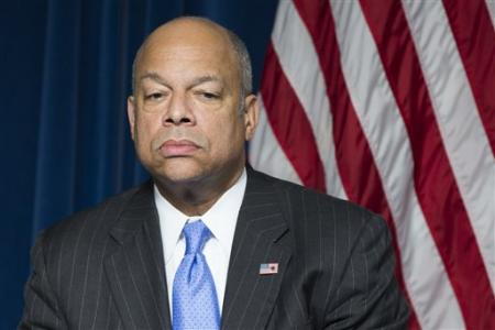 """Homeland Security Secretary Jeh Johnson pauses during a ceremony in Washington, Monday, March 16, 2015, to sign a preclearance agreement as part of the Beyond the Border Initiative with Canadian Minister of Public Safety and Emergency Preparedness Steven Blaney. According to the Homeland Security Department, the agreement will allow """"for the immigration, customs and agriculture inspections required for entry into either country to occur on foreign soil – will reduce congestion and delays at the border and increase efficiency and predictability in cross-border travel, tourism and transportation."""" (AP Photo/ Evan Vucci)"""