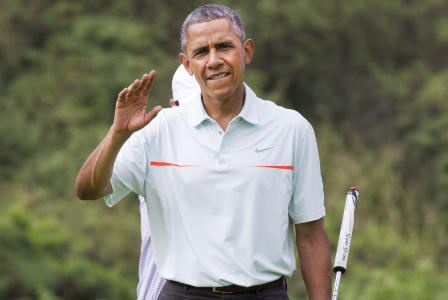 President Barack Obama waves to the traveling press as he plays golf with Malaysian Prime Minister Najib Razak Wednesday, Dec. 24, 2014, at Marine Corps Base Hawaii's Kaneohe Klipper Golf Course in Kaneohe, Hawaii during the Obama family vacation. (AP Photo/Jacquelyn Martin)