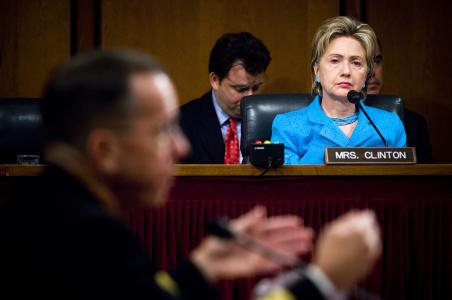 070731-N-0696M-156 WASHINGTON, D.C. (July 31, 2007) - As Senator Hillary Clinton listens, Chief of Naval Operations, Adm. Mike Mullen responds to a question during his confirmation hearing in front of the Senate Armed Services Committee for appointment to Chairman and Vice-Chairman of the Joint Chiefs of Staff at Hart Senate Office Building, July 31, 2007. Mullen was joined by Commander, U.S. Strategic Command, Gen. James E. Cartwright for his appointment to Vice-Chairman of the Joint Chiefs of Staff. DoD photo by Mass Communication Specialist 1st Class Chad J. McNeeley (RELEASED)