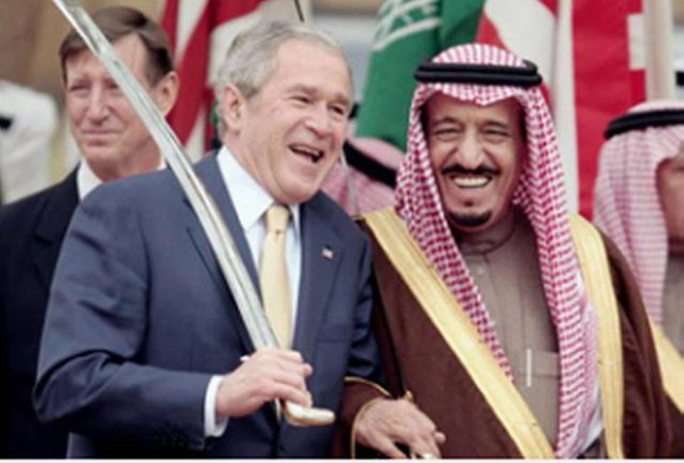 Description: President George W. Bush with then-Prince Salman Bin Abdul Aziz in 2008.