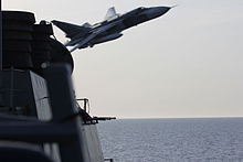 https://upload.wikimedia.org/wikipedia/commons/thumb/e/e9/A_Russian_Sukhoi_Su-24_makes_a_very-low_altitude_pass_by_the_USS_Donald_Cook_%28DDG_75%29.jpg/220px-A_Russian_Sukhoi_Su-24_makes_a_very-low_altitude_pass_by_the_USS_Donald_Cook_%28DDG_75%29.jpg
