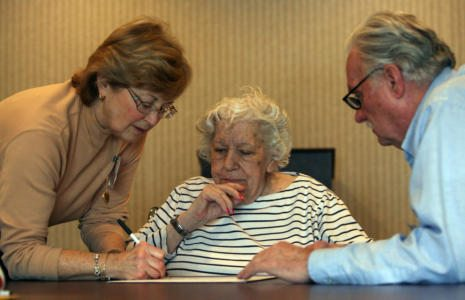 Mary Miceli, 90, a resident of Altercare of Mentor, gets ready to cast her vote in the primary, assisted by Barbara McMahan, left, and Ron Plumb, volunteers at the Lake County Board of Elections. The voting among nursing home residents took place one at a time in the chapel room on Wed., Feb. 13, 2008 (Thomas Ondrey/The Plain Dealer)