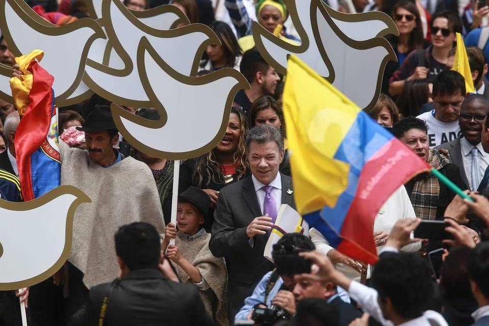 Colombian President Juan Manuel Santos carried a copy of the peace agreement with the FARC guerrillas on his way to the National Congress in Bogotá on Thursday.