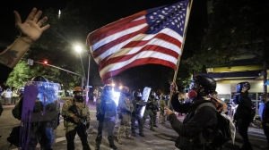 Oregon police in Portland try to quell nightly protests, riots
