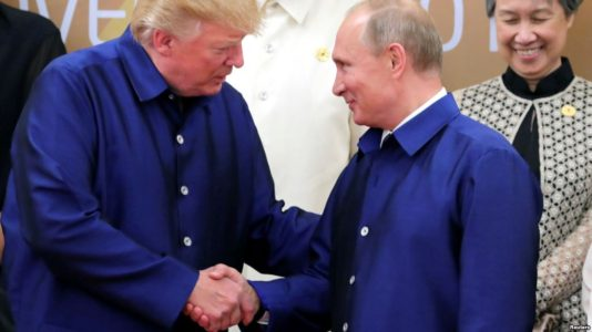 Trump and Putin shake hands at summit in Danang, Vietnam