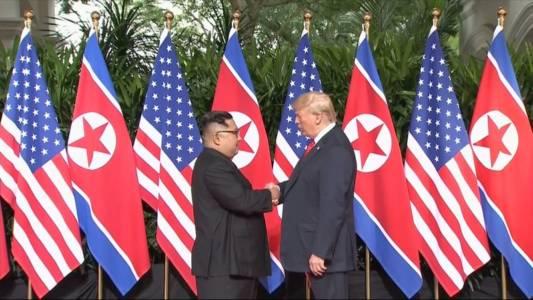 Trump, Kim shake hands to open momentous summit.