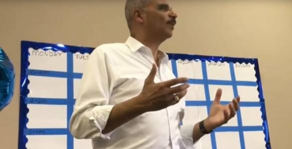 Watch Eric Holder Tell a Crowd to 'Kick' Republicans.