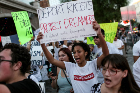 Judge blocks Trump move to end DACA.