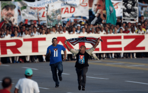 VIDEO: Cuban Dissident Beaten for Interrupting Communist May Day Parade Waving U.S. Flag