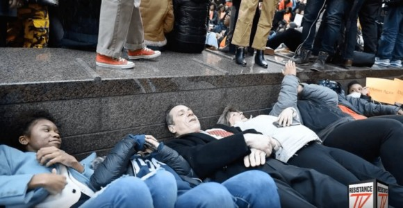 New York Governor Andrew Cuomo Takes Part in Anti-Gun Die-In Protest – Surrounded by Armed Guards.