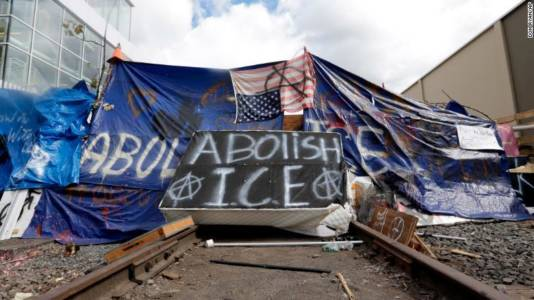 "Feds Dismantle ""Occupy ICE"" Blockade After Playing ""Mind Games"" Involving Metallica And An Eagle Mask"