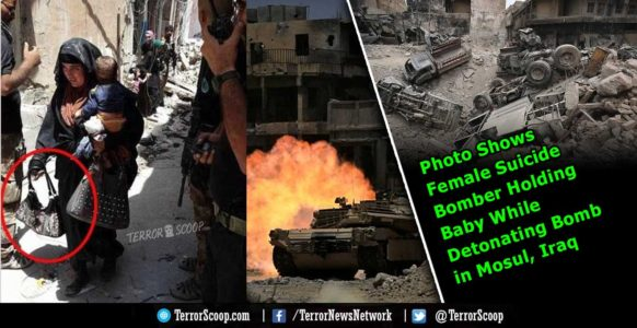 PHOTO: Seconds from detonation: Female Muslim suicide bomber holding her BABY is pictured moments before she DETONATES