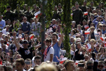'Make America Great Again' hats, Trump flags greet president in Poland