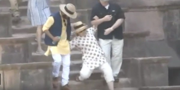 VIDEO: Hillary slips down stairs in India — despite two men holding her up