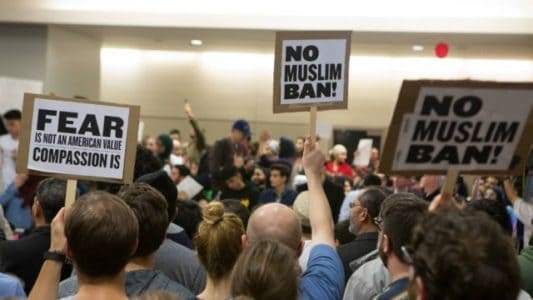 DHS suspends 'any and all actions' on Trump travel ban