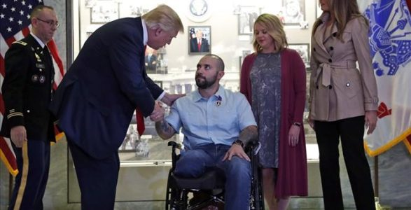 Trump awards Purple Heart at Walter Reed military hospital.