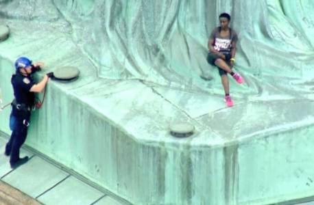 """Abolish ICE"" Protester Who Created 4-Hour Standoff After Climbing Statue of Liberty is Immigrant From Congo."