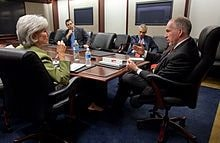 Description: http://upload.wikimedia.org/wikipedia/commons/thumb/5/52/John_Brennan_briefs_Kathleen_Sebelius_on_H1N1_4-28-09.jpg/220px-John_Brennan_briefs_Kathleen_Sebelius_on_H1N1_4-28-09.jpg