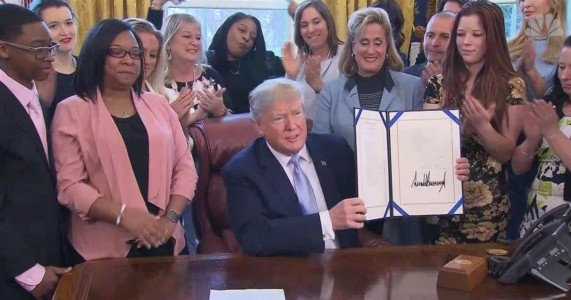 Trump Signs Law Fighting Sex-Trafficking — But The Woman Behind Him Steals The Show.