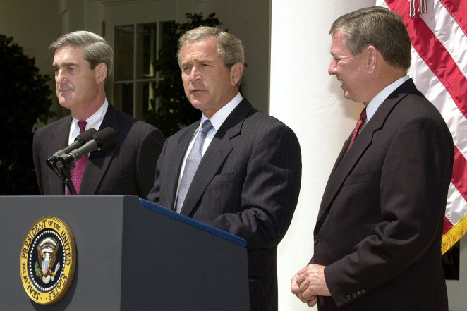 George W. Bush (center) with Robert Mueller (left) in a Rose Garden ceremony.