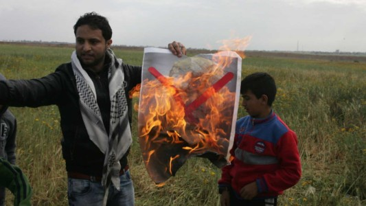Palestinian Arabs Burn Pictures Of Trump As Tens Of Thousands Try To Invade Israel's Gaza Border; 12 Dead.