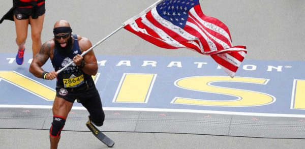 INSPIRE: War-Wounded Amputee Runs Boston Marathon Hoisting Huge American Flag.