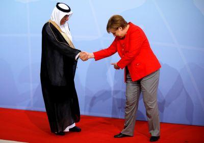 G20 Summit Embarrassment: Germany's Merkel Bows To Saudi Arabian State Minister
