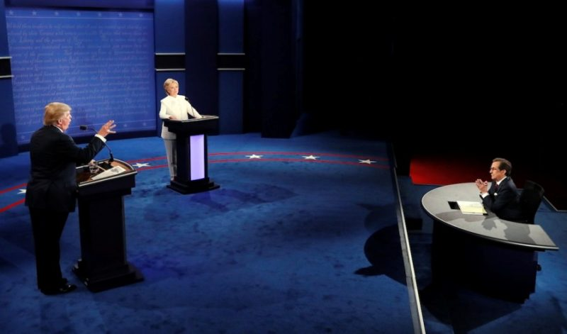 Moderator Chris Wallace questions Democratic presidential nominee Hillary Clinton and Republican presidential nominee Donald Trump during the third presidential debate at UNLV in Las Vegas, Wednesday, Oct. 19, 2016. (Mark Ralston/Pool via AP)