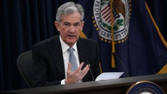 Fed raises interest rates again as unemployment nears record lows.