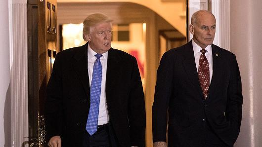 President-elect Donald Trump and U.S. Marine Corps General John Kelly emerge from the clubhouse following their meeting at Trump International Golf Club, November 20, 2016 in Bedminster Township, New Jersey.