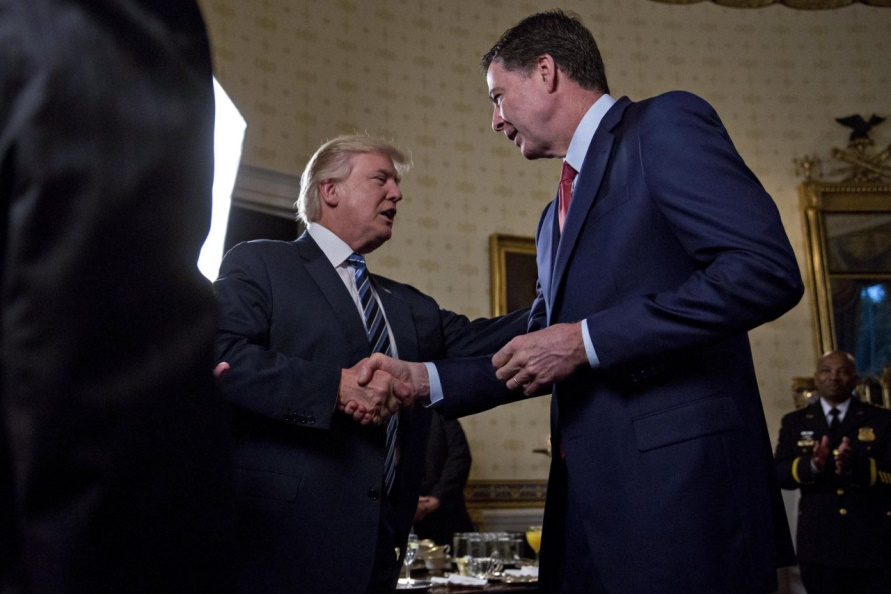 President Trump shakes hands with then-director of the FBI, James Comey, during a Jan. 22 inaugural event for law enforcement officials at the White House.