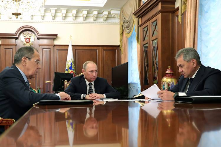 Russian Foreign Minister Sergei Lavrov, left, meets with President Vladimir Putin, center, and Defense Minister Sergei Shoigu at the Kremlin in Moscow on Thursday.