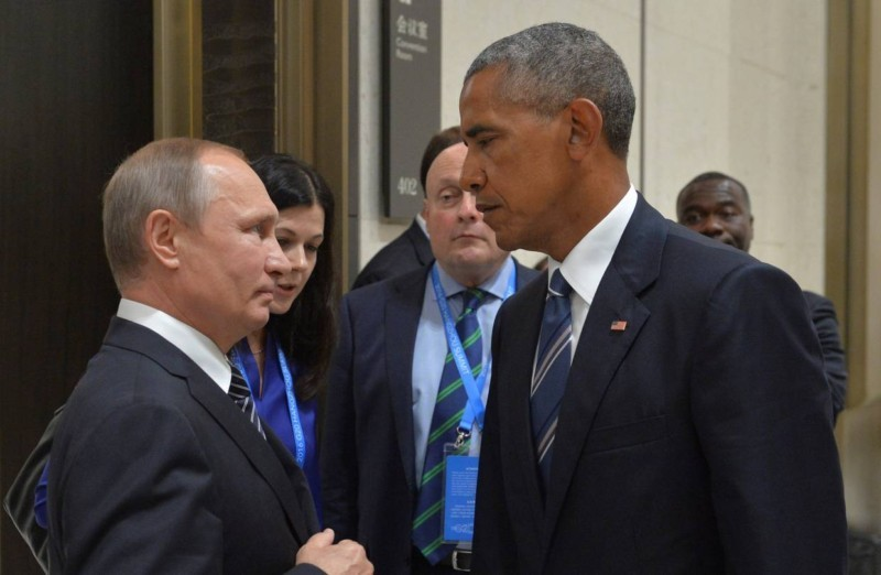Russian President Vladimir Putin met with President Barack Obama on the sidelines of the G-20 Summit in Hangzhou, China, in September. The U.S. set sanctions against Russia on Thursday.