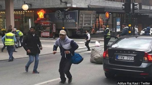 Stockholm truck crash: 'Three dead and shots fired' as truck ploughs into pedestrians in suspected jihad attack