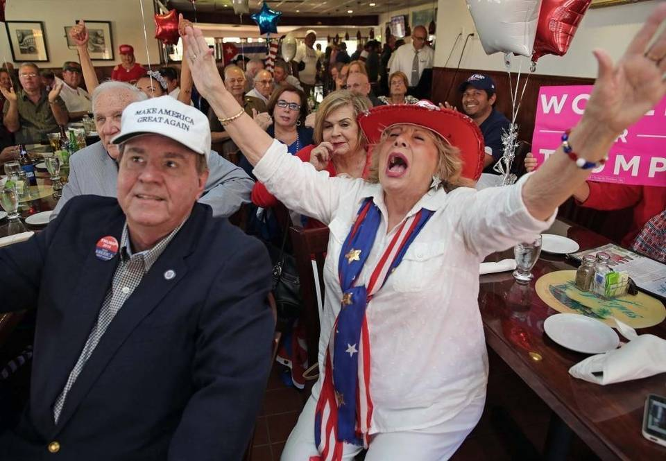 Trump supporter Martie Mees raises her hands in victory as President-elect Donald J. Trump is inaugurated president of the United Stated at a Las Vegas Restaurant celebration party on Coral Way in Miami on Friday, Jan. 2, 2017. On the left is Frank De Varona.
