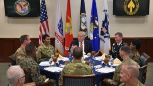 Trump pledges to build up military in first address to service members